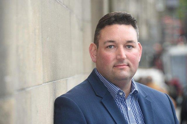 Miles Briggs says carers are often left to 'fall off a cliff edge'