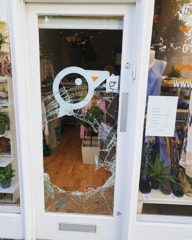 The glass door of Rosy Penguin on Morningside Road smashed by thieves in the early hours of Saturday morning (Photo: Rosy Penguin).