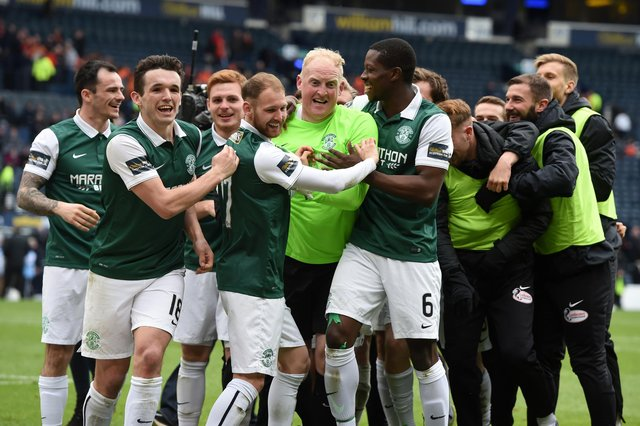Hibs' stand-in goalkeeper Conrad Logan (centre) is mobbed by his team-mates after the Leith side defeated Dundee United on penalty kicks in the 2016 Scottish Cup semi-final. Photo by Craig Williamson/SNS Group