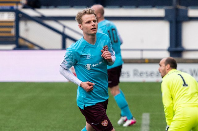 Gary Mackay-Steven wheels away after opening the scoring for Hearts. Picture: SNS
