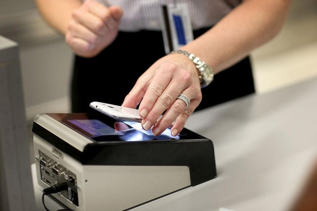 Digital passports could be used by travellers to prove they have been vaccinated against Covid-19, but there are some big questions to be answered (Photo: Joe Raedle/Getty Images)
