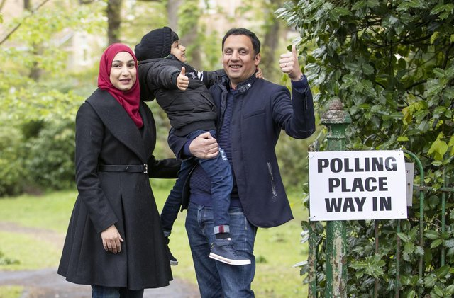 Scottish Labour party leader Anas Sarwar, with wife Furheen and son Ailyan, arrives to deliver his postal vote in the Scottish Parliamentary election at Pollokshields Burgh Hall in Glasgow.