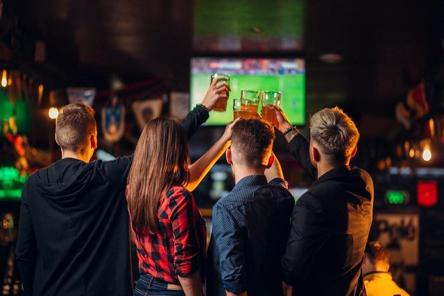 Friends watching football in the pub
