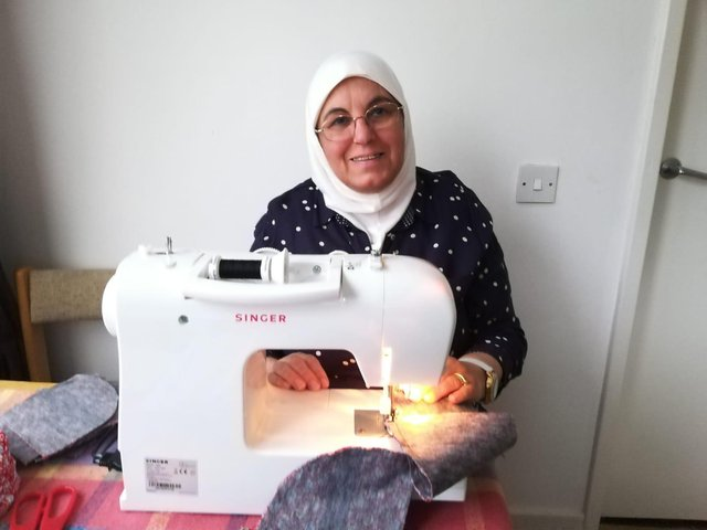 Seven refugee families from Edinburgh are helping protect the city by donating tailor-made face masks to community groups.