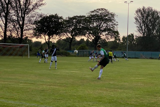 Jayden Fairley takes a free kick during the first half of Hibs' 5-3 win against Civil Service Strollers