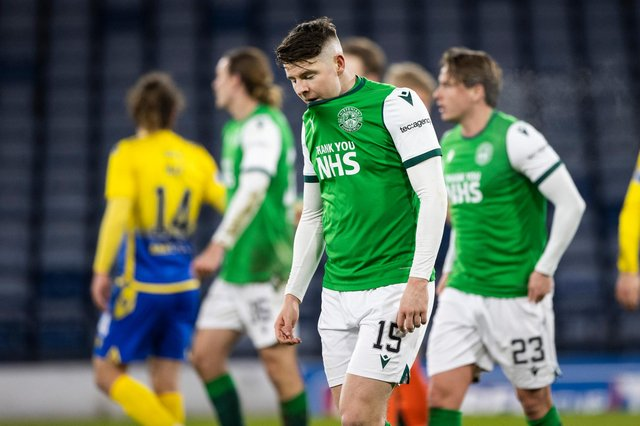 Kevin Nisbet is dejected at full time of the Betfred Cup semi-final between Hibs and St Johnstone