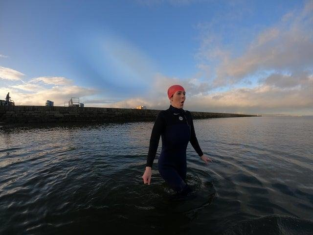 Braving a chilly dip: Evening News reporter Jolene Campbell at Wardie Bay