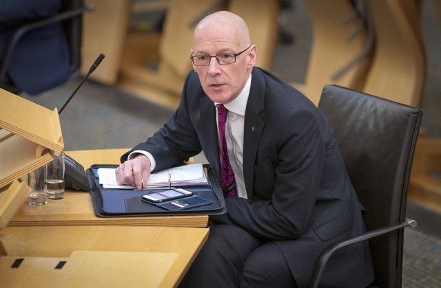 """Deputy First Minister John Swinney said that ipads are the """"jotters of the 21st century""""."""