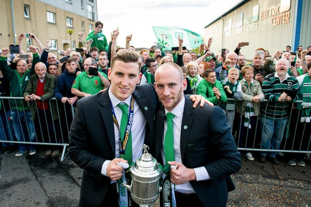 Hibs' Paul Hanlon (left) and David Gray celebrate with the fans after winning the 2016 Scottish Cup final. Photo Ross Parker/SNS Group