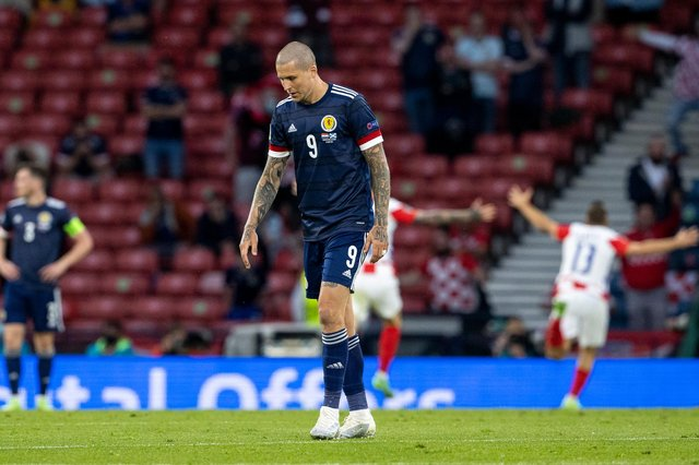 Scotland's Lyndon Dykes looks on dejectedly after a 3-1 defeat by Croatia.