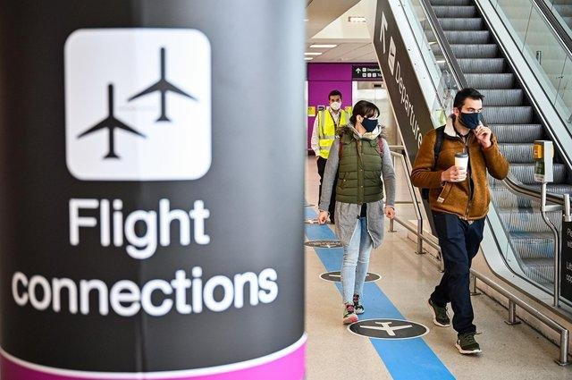 Travellers wearing face masks at Edinburgh Airport.
