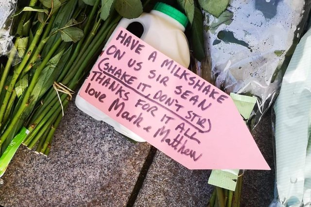 Fans pay their respects with a carton of milk.
