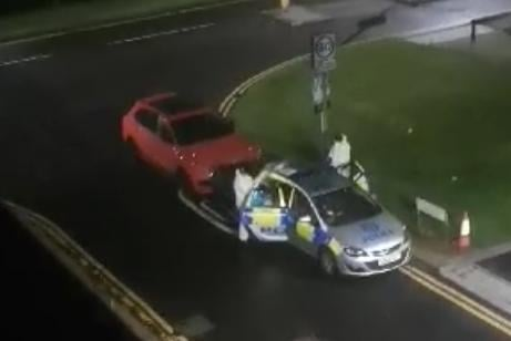 Forensics officers were captured on video at the scene in the early hours of Wednesday morning.