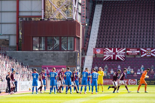 The Inverness players applaud Hearts on to the field at Tynecastle.