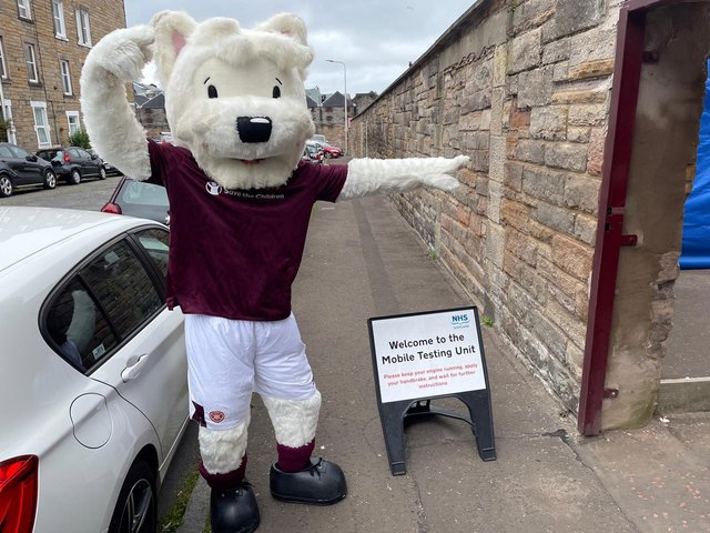 Hearts mascot Jock points the way to the testing centre at Tyencastle