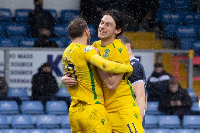 Joe Newell celebrates with Martin Boyle after the equaliser