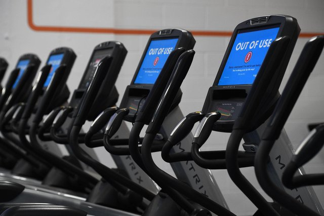 Out Of Use markers on exercise machines inside one of the company's gyms.