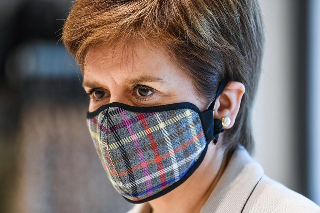 Nicola Sturgeon donned a tartan face mask for the visit to a New Look store at Fort Kinnaird, Edinburgh. Pictures: Jeff Mitchell/Getty