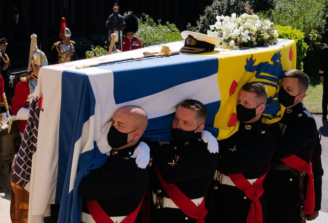 The Duke of Edinburgh's coffin, covered with his Personal Standard, being carried into St George's Chapel, Windsor Castle, Berkshire.