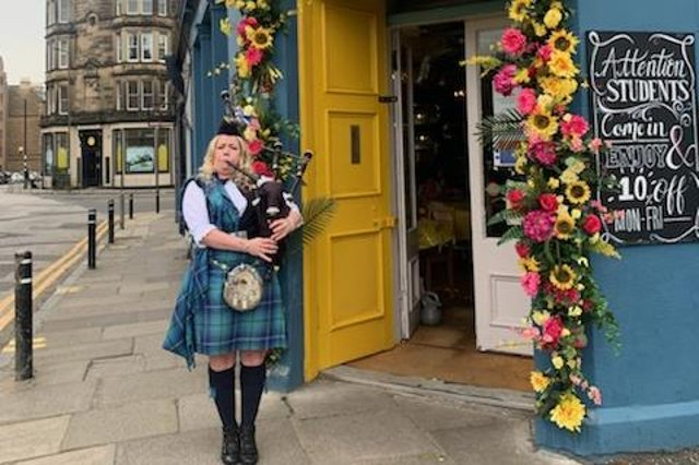 City's piper Lou Marshall welcomes customers to Piecebox