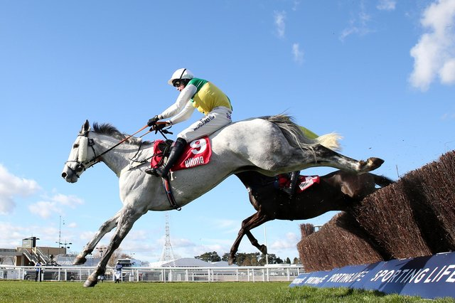 Vintage Clouds ridden by Ryan Mania jumps the last en route to winning the Ultima Handicap Chase on Day One of the Cheltenham Festival. Picture: Michael Steele/Getty Images
