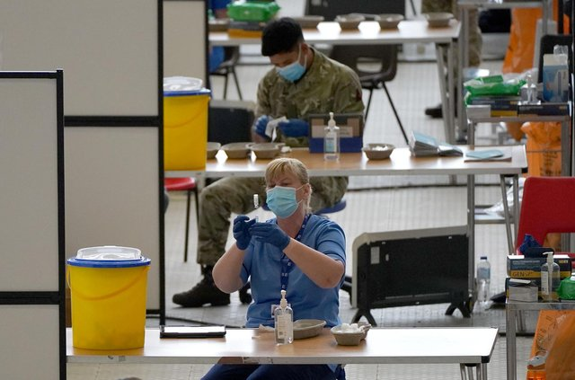 A nurse with a vial of vaccine at the vaccination centre at Ravenscraig Regional Sports Facility in Motherwell, Scotland. Picture date: Friday June 11, 2021.
