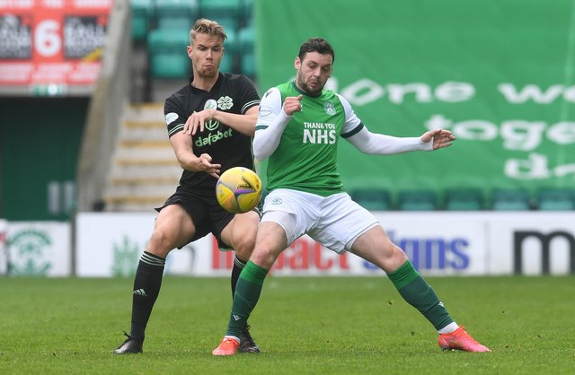 Kris Ajer of Celtic and Hibs' Drey Wright battle for the ball at Easter Road