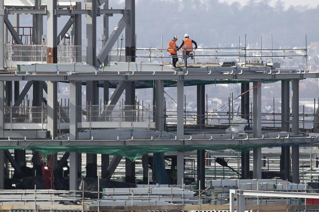 Workers on the site of the new St James Quarter development in Edinburgh city centre during its construction. Picture: Jane Barlow/PA Wire