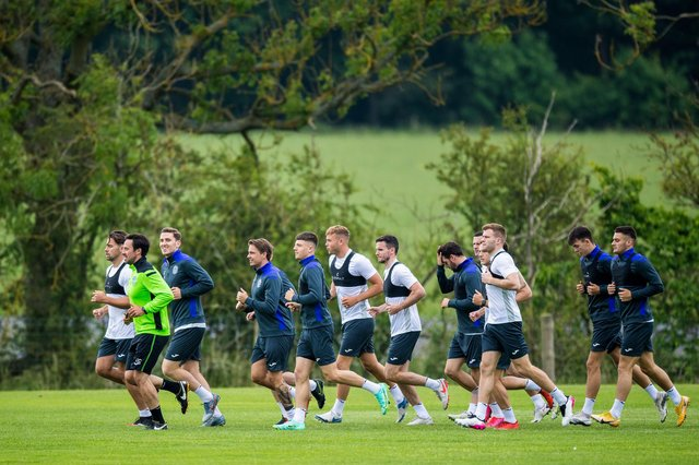 Colin Clancy puts the Hibs first-team squad through their paces at East Mains