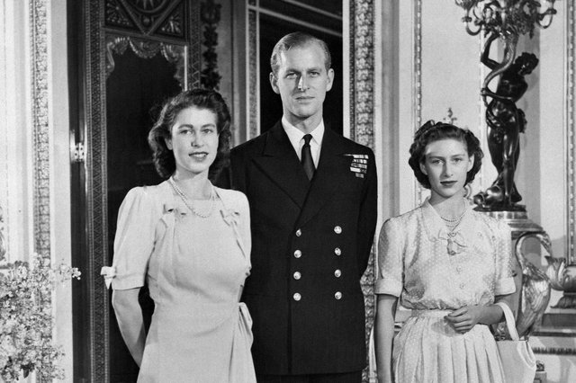 Princess Elizabeth (future Queen Elizabeth II), Philip Mountbatten (also the Duke of Edinburgh) and Princess Margaret pose in the Buckingham Palace on July 09, 1947 in London, the day their engagement was officially announced.