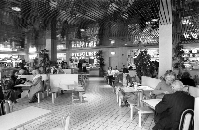 Shoppers in the Food Court (Spud U Like baked potato shop in background) of the newly-opened Cameron Toll shopping centre in Edinburgh, April 1985.