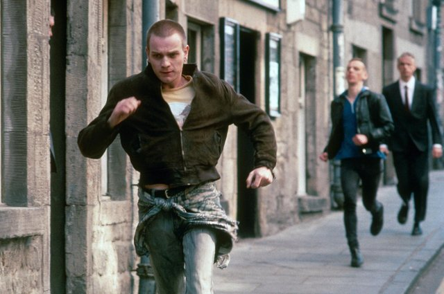 Renton and Spud are chased by security guards in a scene from Trainspotting (Picture: Liam Longman/Figment/Noel Gay/Kobal/Shutterstock)