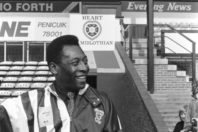 Brazilian football legend Pele smiles during a visit to Tynecastle football ground in Edinburgh, June 1989.