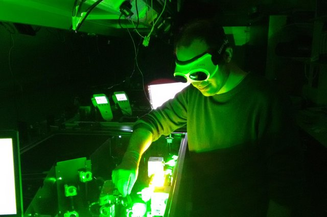 Professor John Travers uses a laser at Heriot-Watt University.
