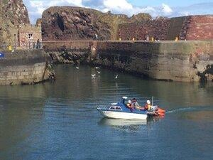 The lifeboat tows the stricken vessel into Dunbar harbour. Picture: Ian Wilson/Dunbar RNLI