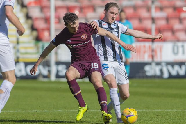 Hearts' Andy Irving and Dunfermline's Declan McManus jostle for possession.