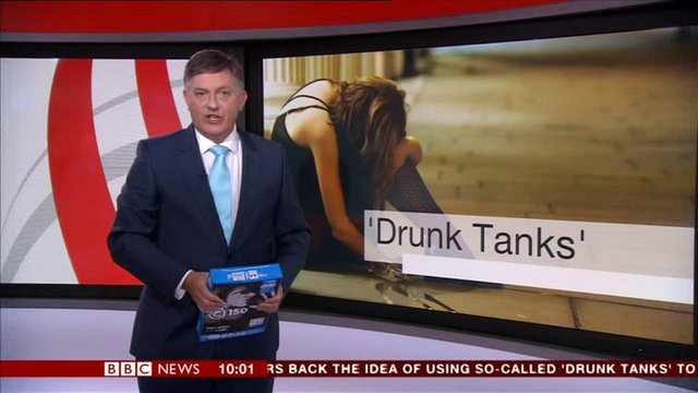 Viewers saw Simon McCoy holding a packet of A4 paper instead of a tablet while presenting an news story on BBC One. Image: BBC