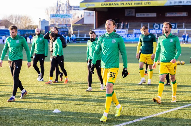 Hibs warm up at Palmerston ahead of the match