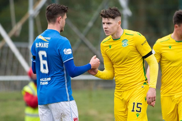 Hibs' Kevin Nisbet with Connor McManus at full time during the Scottish Cup tie between Stranraer and Hibs.