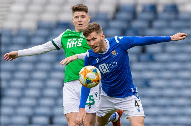 St Johnstone defender Jamie McCart, pictured against Hibs' Kevin Nisbet, is reportedly a target for the Easter Road club.