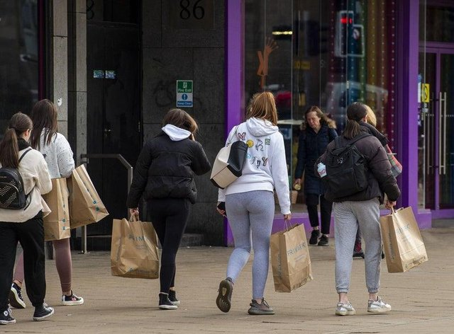 Shoppers pictured carrying Primark bags on Monday morning after they have visited the store for the first time in months. Photo: Lisa Ferguson