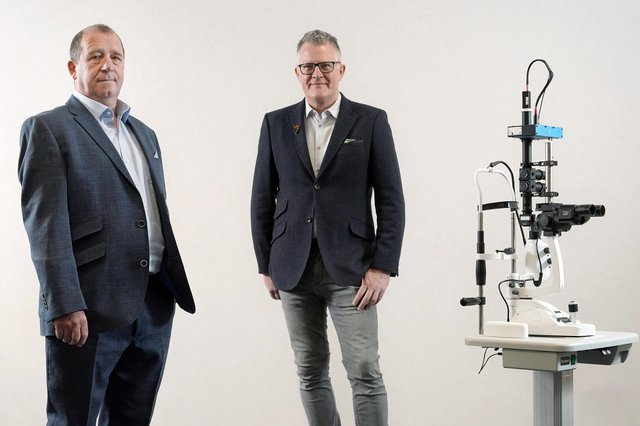 Graham Bell and David Quigley of Edinburgh Biosciences with the company's LEDINBIO device. Picture: Stewart Attwood