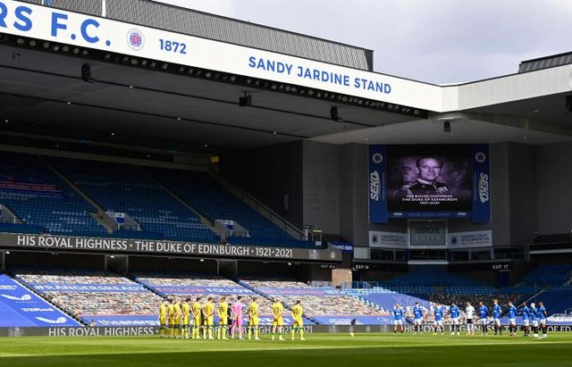 The players observe a minute's silence in memory of Prince Philip during a Scottish Premiership match between Rangers and Hibernian at Ibrox Stadium, on April 11, 2021, in Glasgow, Scotland. (Photo by Rob Casey / SNS Group)