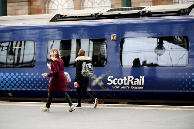 Passengers board a ScotRail train at Glasgow Central Station
