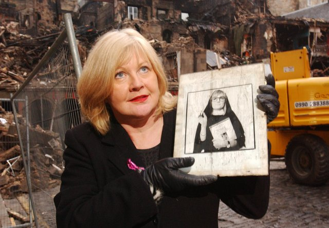 Photo: Andrew Stuart/NWArtistic Director Karen Koren of Fringe venue the Gilded Balloon seen here with an archive photograph of former venue performer comediene Caroline Aherne which was salvaged from the debris of destroyed club premises (behind) on the Cowgate, Edinburgh; December 22, 2002. The Gilded Balloon, the world renown comedy venue which Koren founded 17 years ago, was destroyed by the fire of the 7th December which gutted the Old Town block bordering the Cowgate and South Bridge.