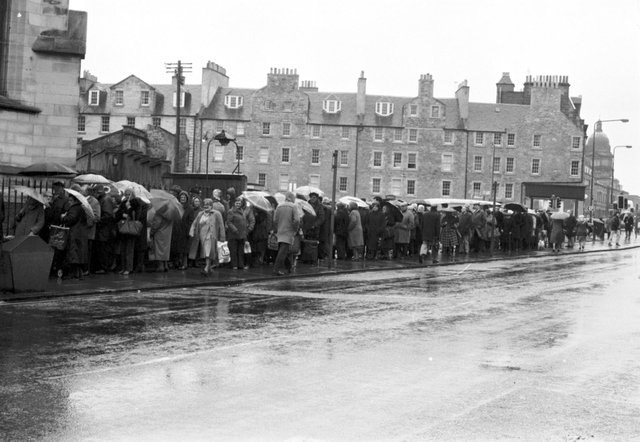 Old age pensioners queue for free butter and cheese from the EEC 'butter mountain' at South Side community centre in Edinburgh, March 1987.