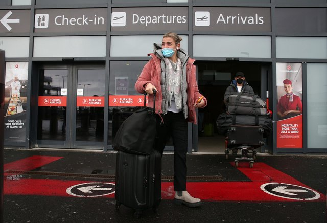 Passengers after arriving at Edinburgh airport, ahead of new quarantine rules in Scotland which mean that from Monday, travellers from any country will be forced to self-isolate in a hotel for 10 days on arrival.