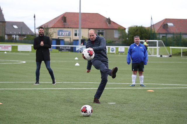The Duke of Cambridge on the pitch during a visit to Spartans FC's Ainslie Park Stadium in Edinburgh to hear about initiatives in Scottish football that champion mental health ahead of the Scottish Cup Final on Saturday picture: PA