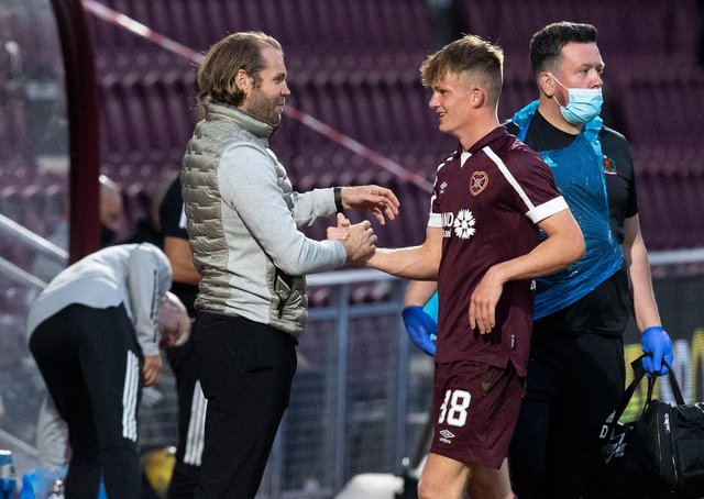 Finlay Pollock is congratulated by Hearts manager Robbie Neilson on Tuesday.