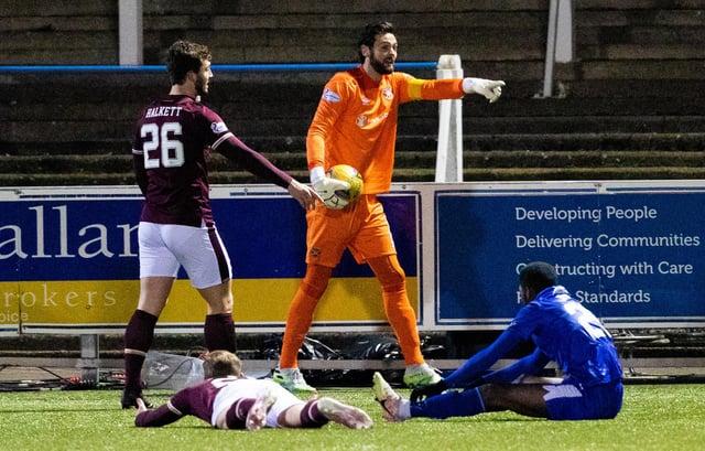 Craig Gordon will return in goal for Hearts against Dunfermline.